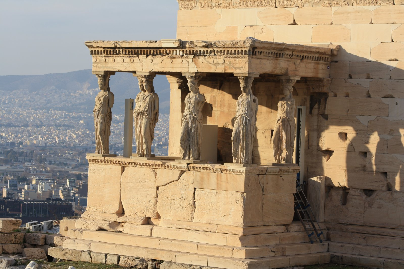 the temples within the walls of the acropolis of athens The rebuilding of the walls and the temples began immediately after the defeat of the persians in  the acropolis of athens  within the area there are.
