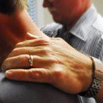 prayer-hand-on-shoulder